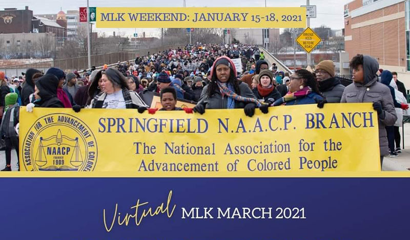 photo of crowd conduction martin luther king day march